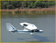 Photo of SeaRey amphibian skimming low over the lake